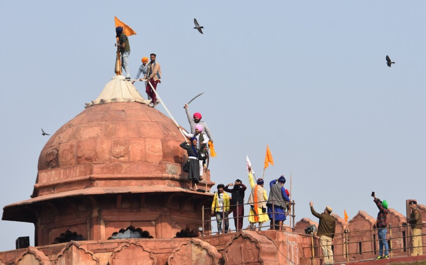 Angry farmers storm India's Red Fort in huge tractor rally - The San Diego  Union-Tribune