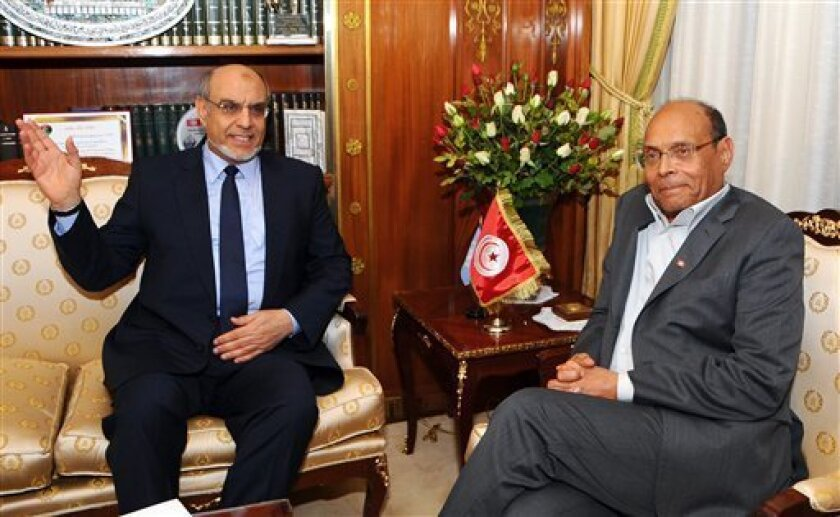 Tunisian President Moncef Marzouki, right, meets Tunisian Prime Minister Hamad Jebali, at the presidential palace of Tunisia, Carthage Palace, Tuesday, Feb. 19, 2013, in Tunis, Tunisia. Tunisia's prime minister announced Tuesday he is resigning following the rejection of his effort to form an apoli