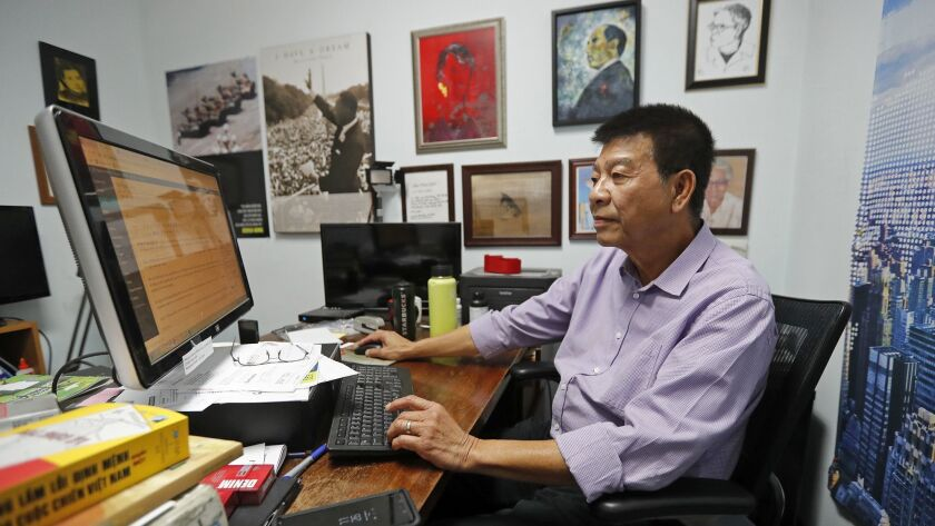 Dinh Quang Anh-Thai, senior editor and assistant to the publisher, searches through daily news artic