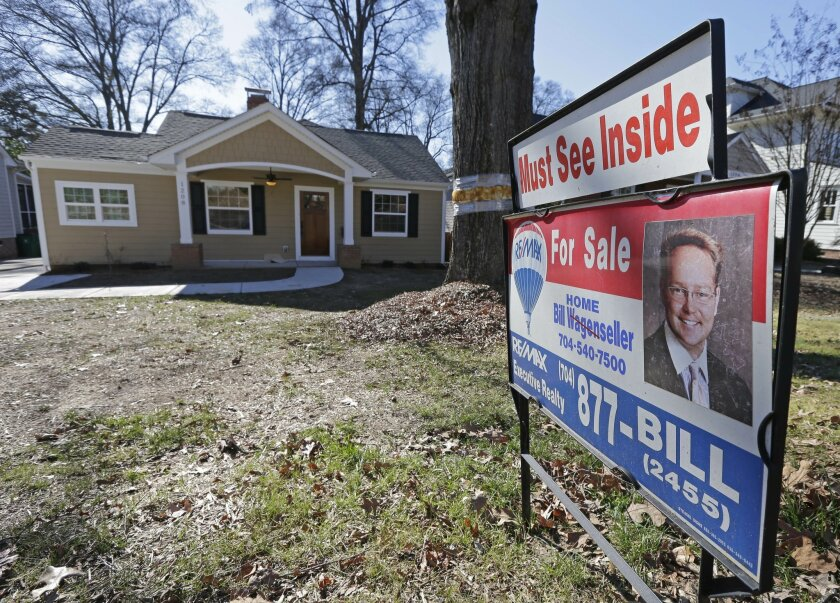 FILE - This Jan. 8, 2015 file photo shows a home for sale in Charlotte, N.C. National Association of Realtors releases existing home sales for July 2015 on Thursday, Aug. 20, 2015. (AP Photo/Chuck Burton, File)