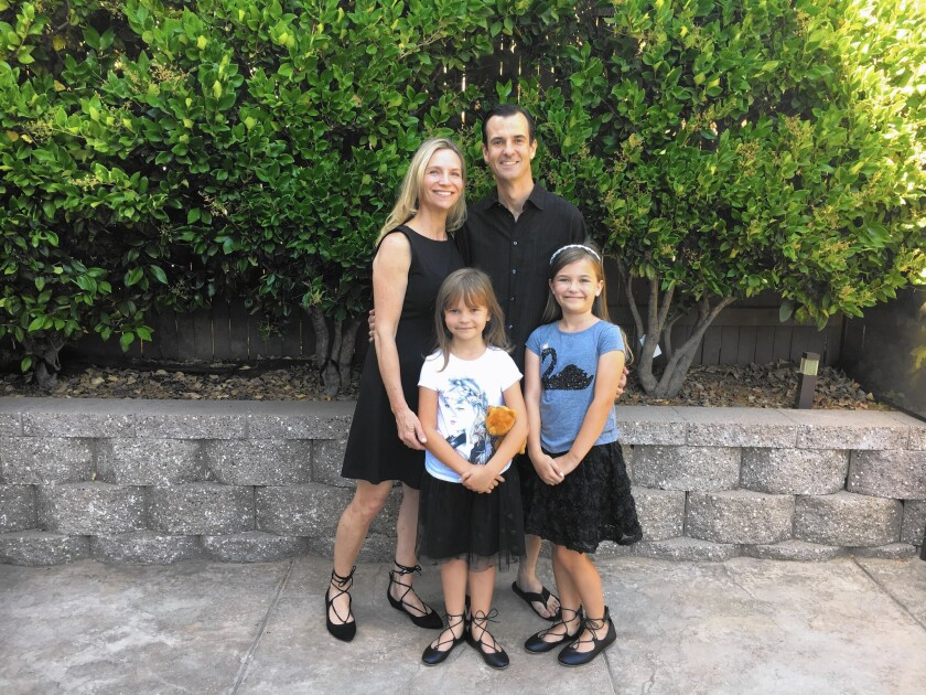 Stacie and Chris French and their daughters. Stacie French travels regularly for work as a flight attendant for Southwest Airlines.