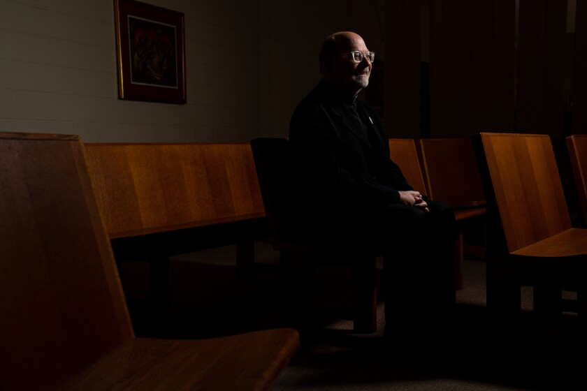 During the coronavirus pandemic, priests such as Father Chris Ponnet of the St. Camillus Catholic Center for Pastoral Care in Los Angeles are continuing to work in hospitals as chaplains or volunteers who administer sacraments to patients.