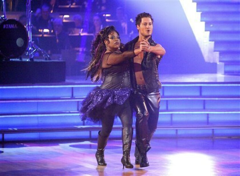 "In this April 9, 2012 photo released by ABC, TV personality Sherri Shepherd and her partner Val Chmerkovskiy perform on the celebrity dance competition series ""Dancing with the Stars,"" in Los Angeles. (AP Photo/ABC, Adam Taylor)"