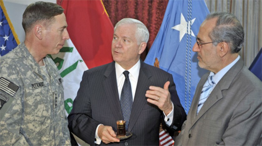 Gates' comments followed a meeting with the commander of U.S. forces in Iraq, Gen. David H. Petraeus, left, and Iraqi National Security Advisor Dr. Al Rubai'e.