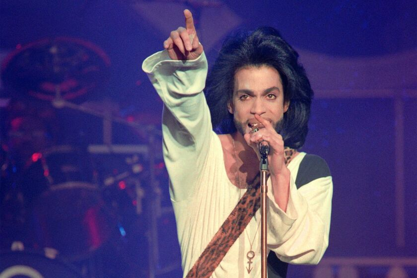 Prince performs at the Parc des Princes stadium in Paris on June 16, 1990. The music pioneer died Thursday in Minnesota.