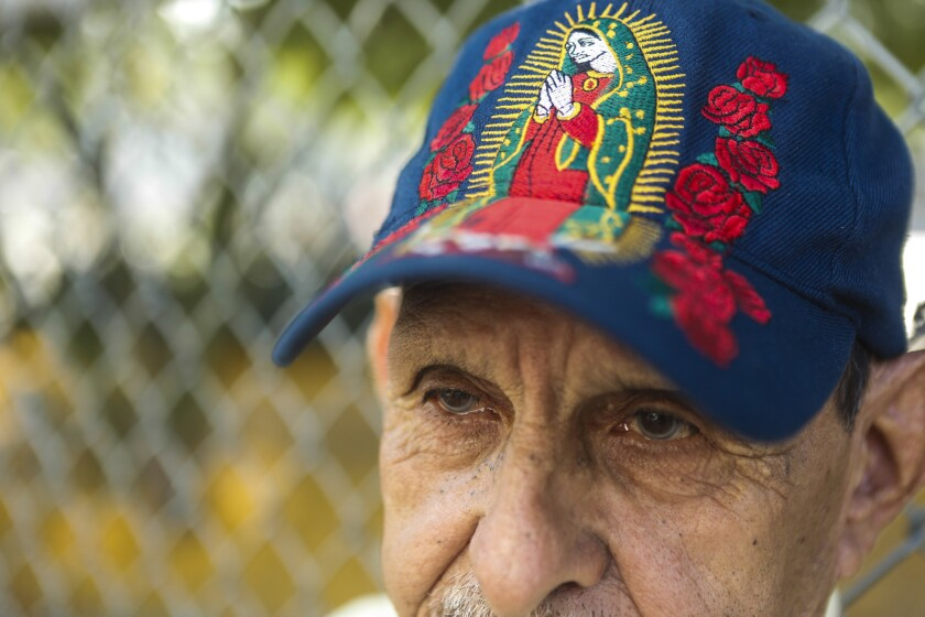 LOS ANGELES, CA -- SATURDAY, AUGUST 25, 2018-- Arturo Carrillo wears a hat of the Virgin Mary as he