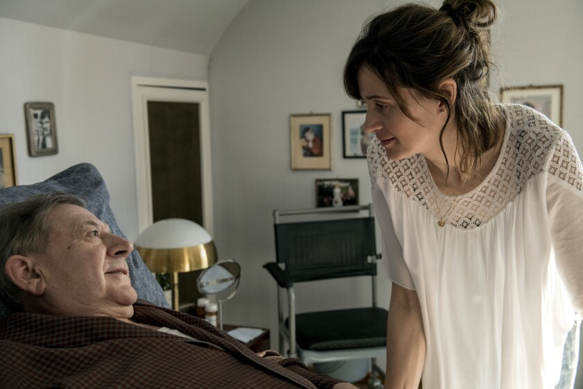 """An elderly man and his young female caregiver in the movie """"My Wonderful Wanda."""""""