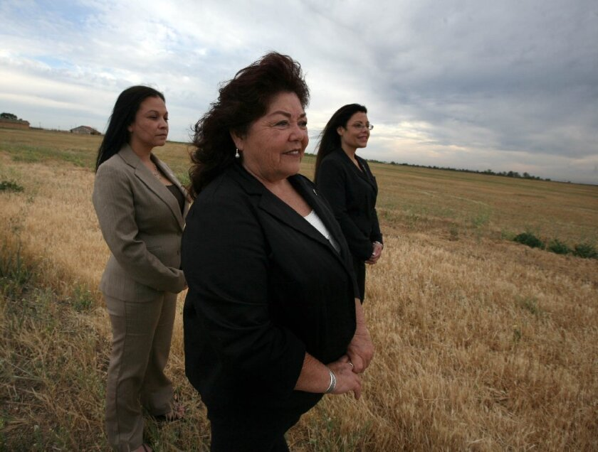 North Fork Mono Rancheria Chariwoman Elaine Bethel Fink, center, stands with two fellow tribal members near Madera, where they hope to build a casino if Proposition 48 passes.