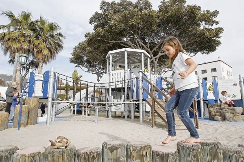 A child plays at the playground for Main Beach Park, which was replaced in 2013.