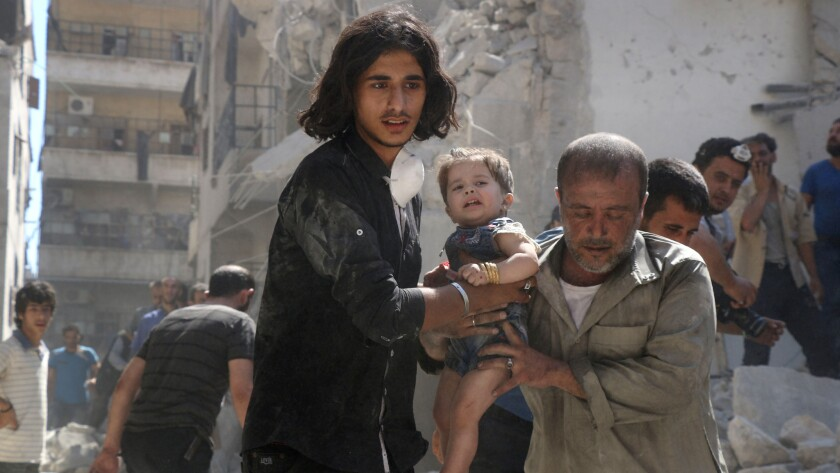 A little girl is rescued from the rubble after a reported airstrike in a rebel-held part of Aleppo, Syria, on Sept. 10, 2016. The U.S. and Russia reached agreement on an initiative to halt the warfare in Syria.