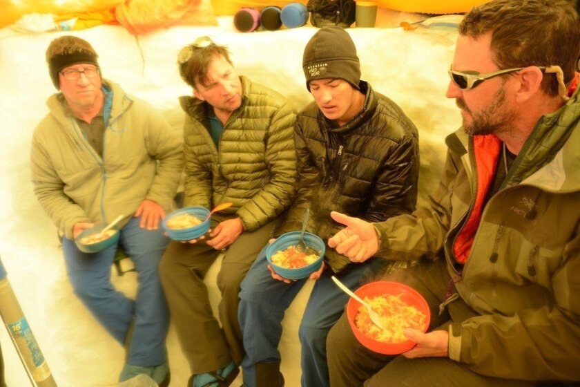 Carlsbad teen Joey Szalkiewicz (second from right) is accompanied by his uncle Bob Szalkiewicz (left); his father, Joe; and former state Assemblyman Nathan Fletcher on a climb up Denali in Alaska.