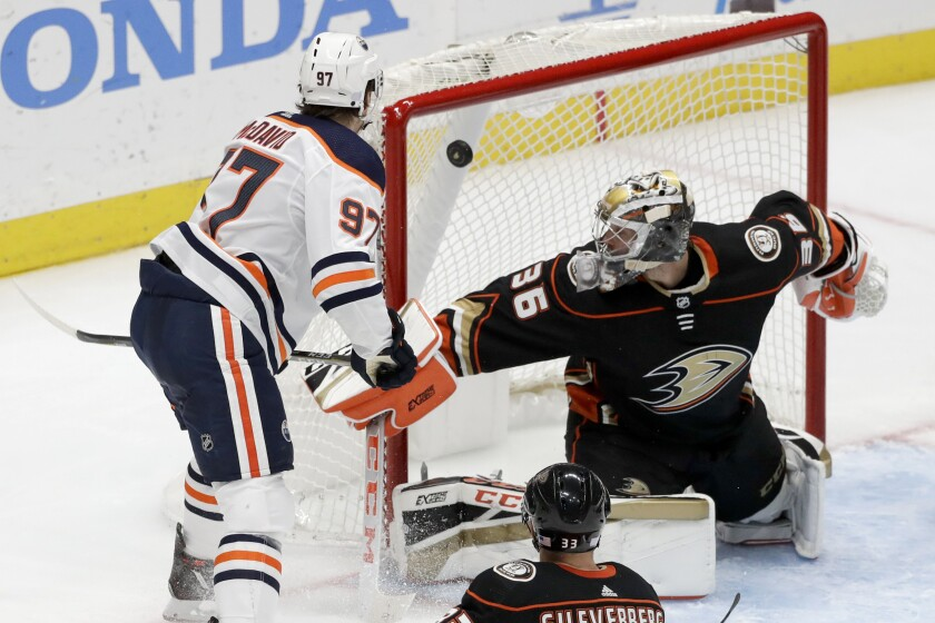 Oilers center Conor McDavid scores against Ducks goaltender John Gibson during the third period on Nov. 10 2019.