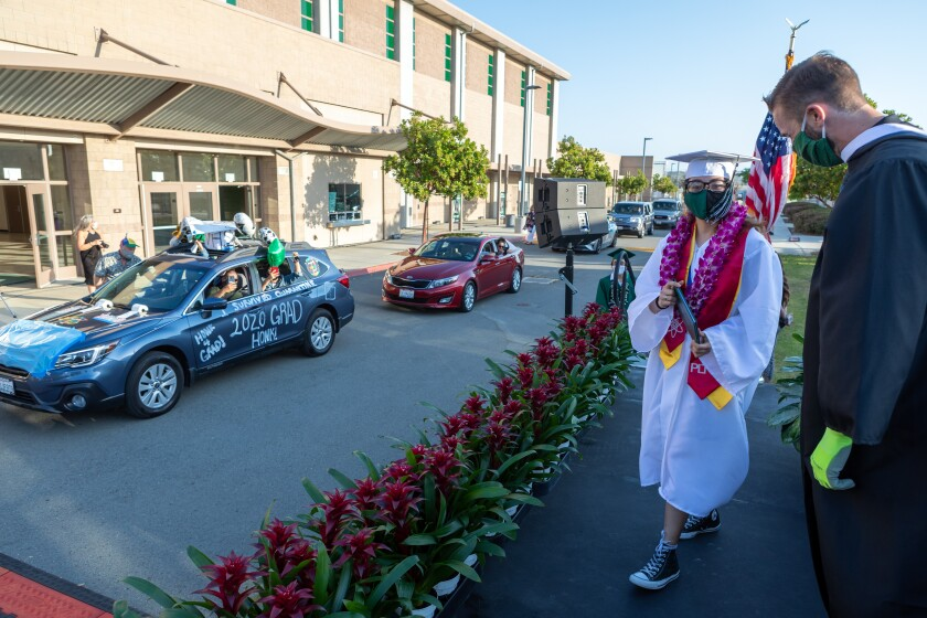 "Mission Vista High School graduate Kiana Garcia took part in the ""drive-through"" graduation ceremony at the school"
