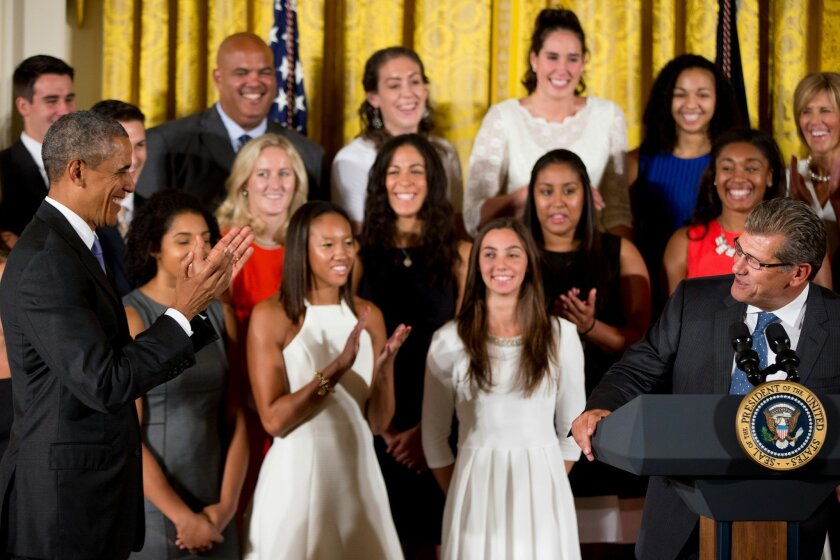 FILE - In this Tuesday, Sept. 15, 2015, file photo, President Barack Obama smiles and applaud as Connecticut women's basketball coach Geno Auriemma, right, speaks in the East Room of the White House in Washington, during a ceremony honoring the 2015 NCAA women's basketball champions. New York Liberty rookie Kiah Stokes is in blue, top row, second from right. On Wednesday, the contender for WNBA rookie of the year was back at practice, gearing up for the playoffs. Stokes has transitioned from defensive role player for the three-time defending champion Huskies to multifaceted spark plug off the bench for the resurgent Liberty, who face the Washington Mystics on Friday in Game 1 of the Eastern Conference series. (AP Photo/Andrew Harnik, File)