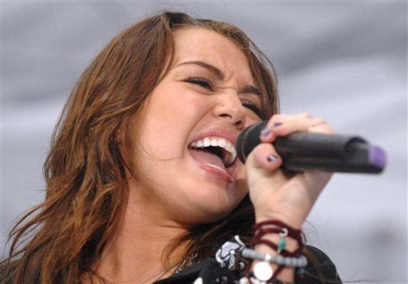 FILE - In this Aug. 28, 2009 file photo, singer Miley Cyrus performs on NBC's 'Today' at Rockefeller Center in New York. (AP Photo/Peter Kramer, file)