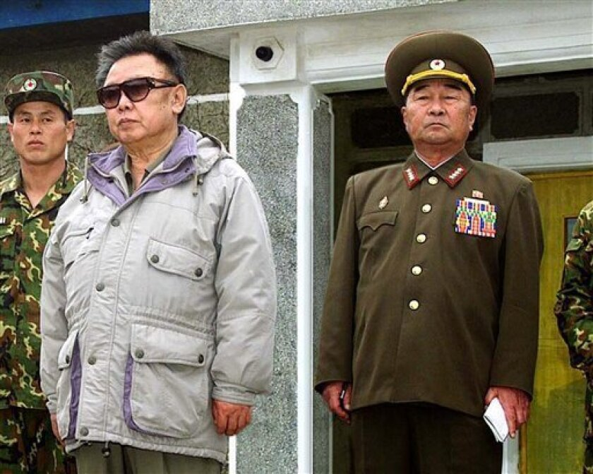 FILE - In this April 23, 2007 file photo released by Korean Central News Agency via Korea News Service in Tokyo, Gen. Kim Kyok Sik, right, stands with then-North Korean leader Kim Jong Il during the leader's inspection of Korean People's Army Unit 1637 at an undisclosed location in North Korea. North Korea replaced hard-line defense chief Kim Kyok Sik with little-known army general Jang Jong Nam. Mention of Jang's new role was buried Monday, May 13, 2013 in a state media dispatch listing those w