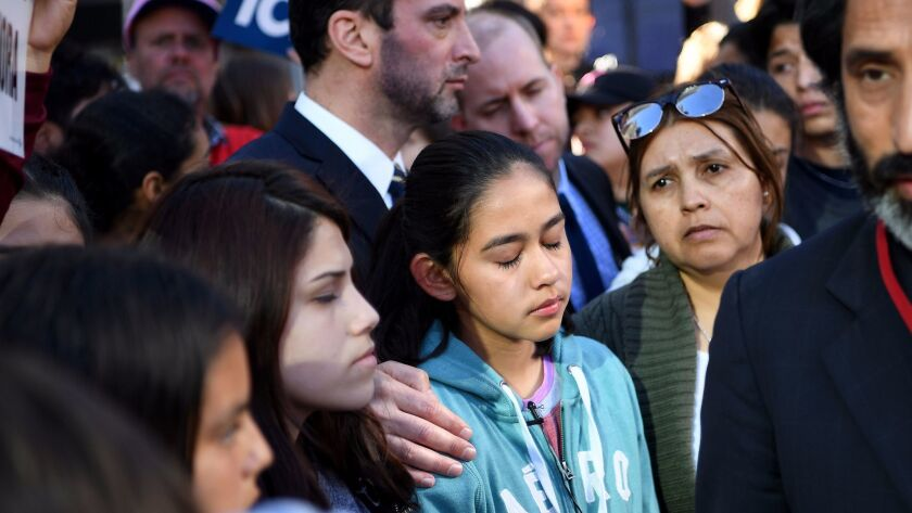 Fatima Avelica, 12, cries during a press conference and rally in downtown Los Angeles after she film