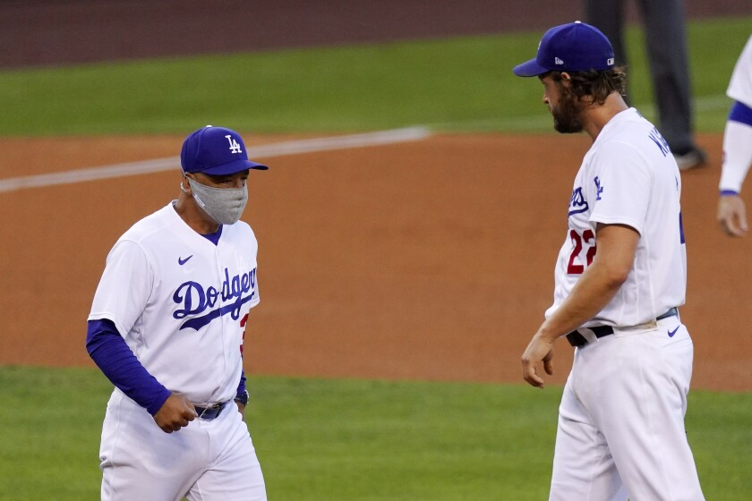 Dodgers starter Clayton Kershaw is taken out of the game by manager Dave Roberts during the fifth inning Aug. 8, 2020.