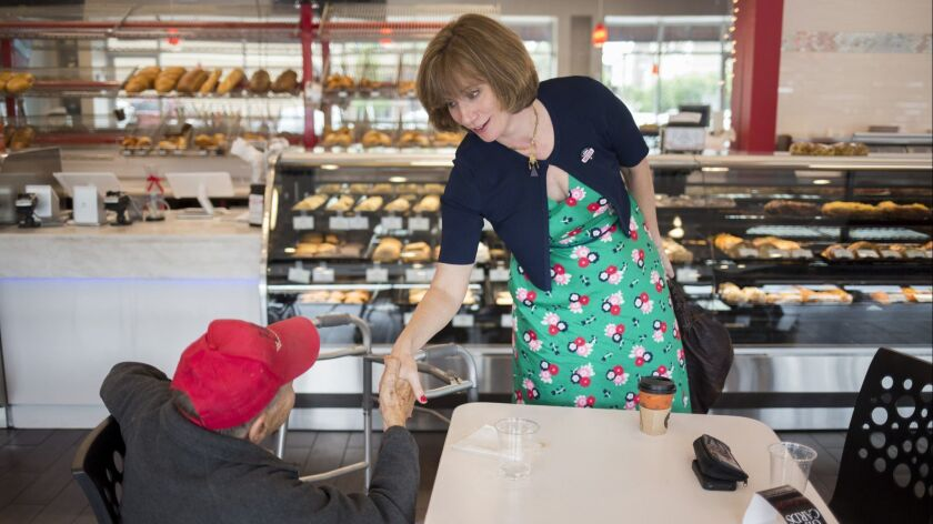 Democratic congressional candidate Laura Moser meets with Sigmund Jucker at one of his Houston bakeries. The writer and liberal activist was attacked by leaders of her own party, who question Moser's electability.
