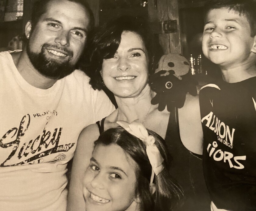 Hunter Smith of National City, left, with his mom, Concetta Antico, and other family members.