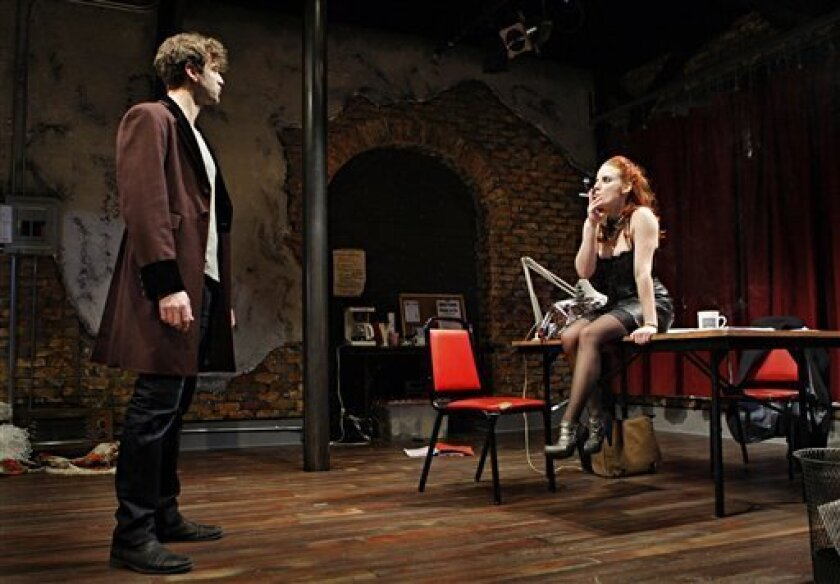 """In this Jan. 29, 2013 photo, Vanda, played by Anna Sundberg, smokes during a dress rehearsal with Thomas, played by Peter Christian Hansen, for the play """"Venus in Fur"""" at the Jungle Theater in Minneapolis, Minn. Minnesota lawmakers are trying to amend the state's smoking ban to eliminate an exempti"""