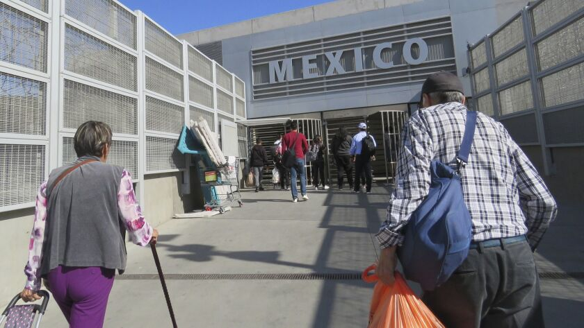 Pedestrians head into Mexico from San Ysidro.