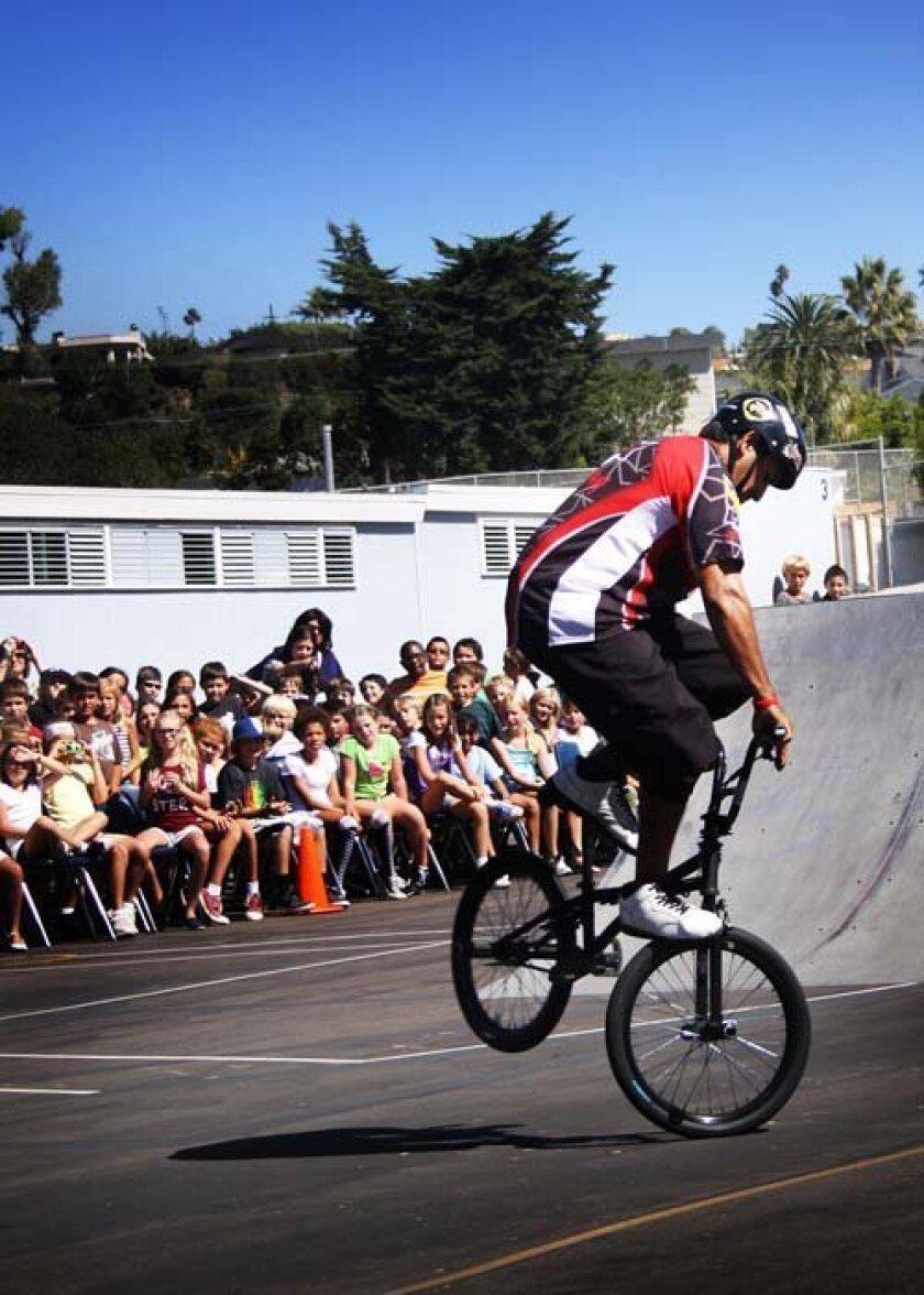 Robert Castillo pops a wheelie.