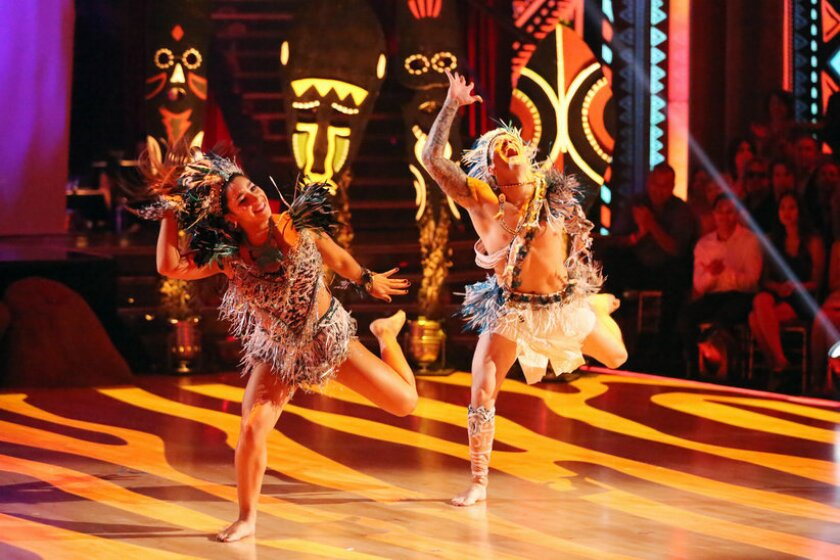 """Aly Raisman and Mark Ballas use a """"The Lion King"""" theme while competing on """"Dancing With the Stars"""" on Monday."""