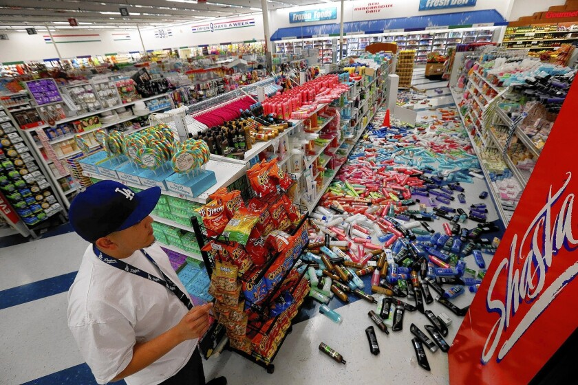 "Cesar Zamora, night manager at a 99 Cent Only store in Brea, looks over aisles of fallen goods after a 5.1 magnitude quake in March. ""Every earthquake makes another earthquake more likely,"" says USGS seismologist Lucy Jones."