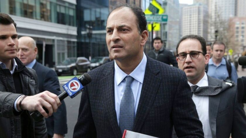 David Sidoo of Vancouver leaves a federal court hearing March 15 in Boston. Sidoo pleaded not guilty to charges in a wide-ranging college admissions scandal.
