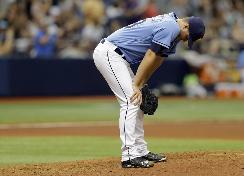 Tampa Bay Rays starting pitcher Jake Odorizzi reacts after giving up a two-run home run to New York Yankees' Starlin Castro during the seventh inning of a baseball game Sunday, May 29, 2016, in St. Petersburg, Fla. (AP Photo/Chris O'Meara)