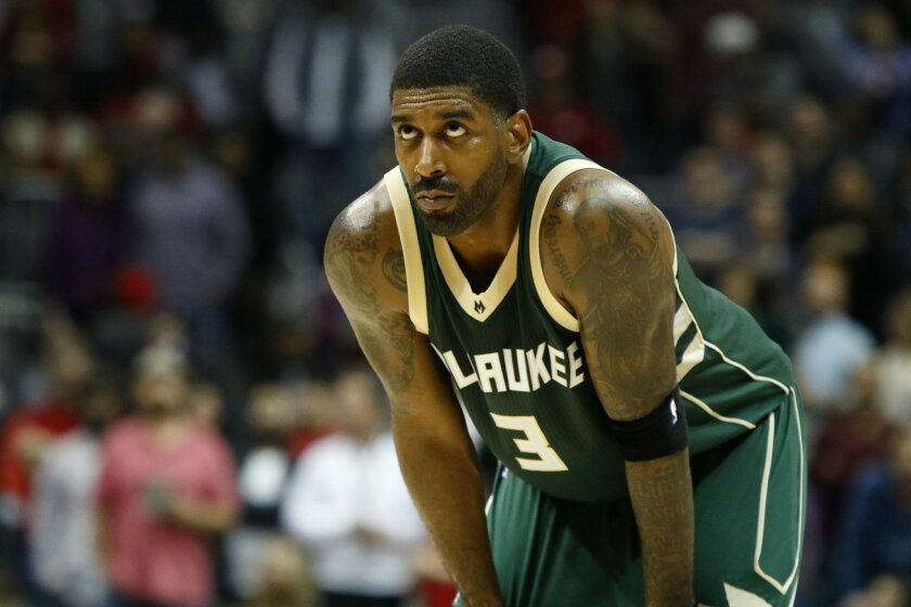 FILE - In this Feb. 20, 2016, file photo, Milwaukee Bucks guard O.J. Mayo waits during a break in the in the second half of an NBA basketball game against the Atlanta Hawks in Atlanta. Mayo has been dismissed and disqualified from the NBA for violating the terms of the league's anti-drug program, t