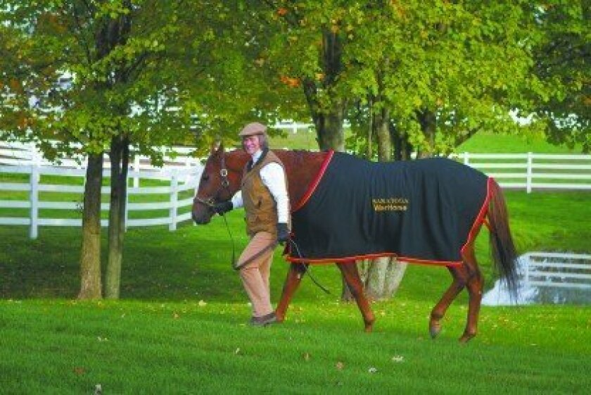 Marilyn Lane in Saratoga Springs with a retired Thoroughbred from the Saratoga WarHorse Project.