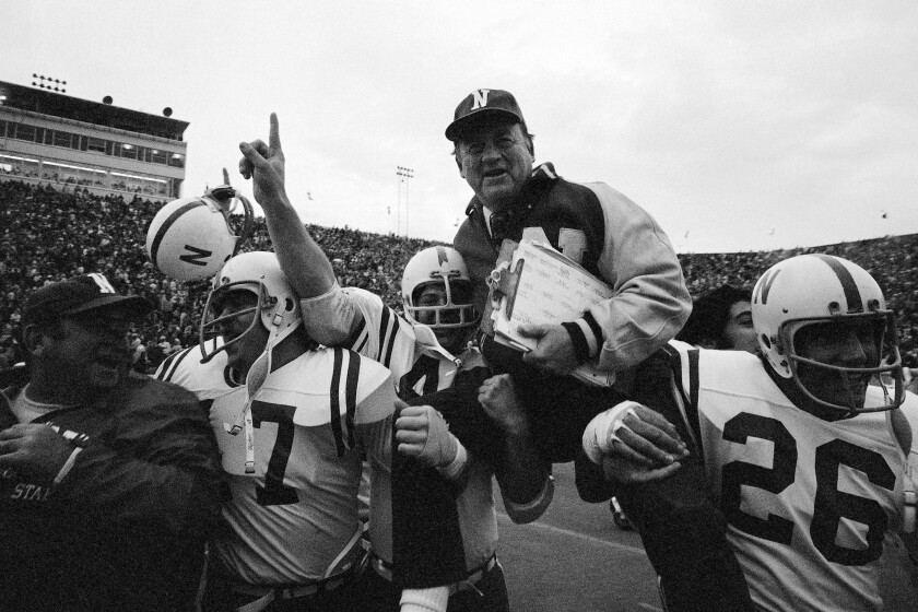FILE - In this Nov. 25, 1971, file photo, Nebraska head coach Bob Devaney is carried off the field by his victorious players after they defeated Oklahoma 35-31 in an NCAA college football game in Norman, Okla., on Thanksgiving Day. The game on Thanksgiving 50 years ago is back in the spotlight as Nebraska and Oklahoma renew their rivalry on Saturday, Sept. 18, 2021. (AP Photo/File)