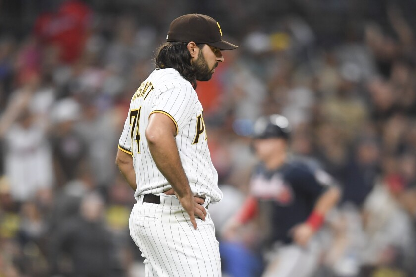Nabil Crismatt of the Padres stands on the mound after giving up a home run during the sixth inning.
