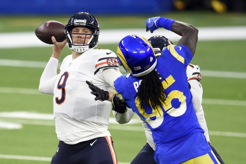Chicago Bears quarterback Nick Foles (9) throws against the Los Angeles Rams during the first half of an NFL football game Monday, Oct. 26, 2020, in Inglewood, Calif. (AP Photo/Kelvin Kuo )