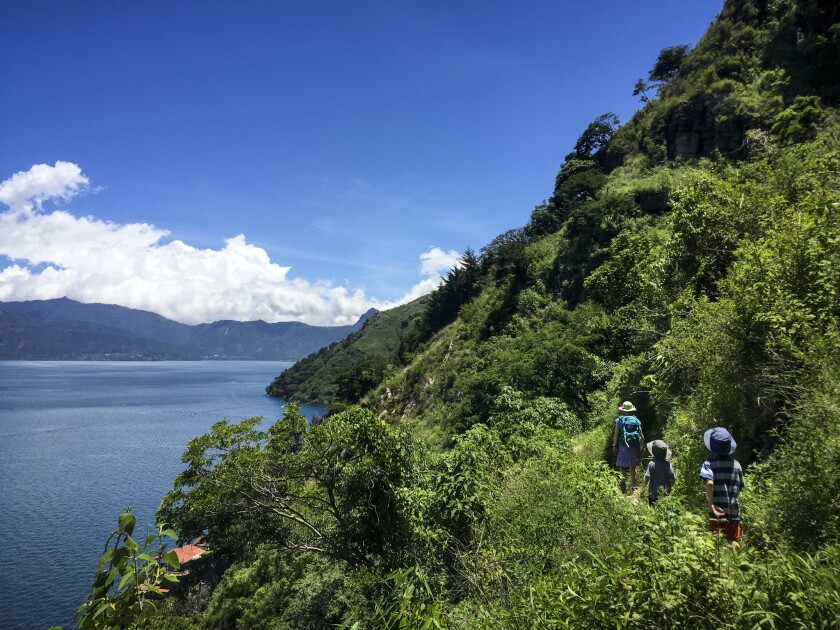 Katie Quirk and her children enjoy a short hike between the Lake Atitlan villages of Santa Cruz and Jaibalito.