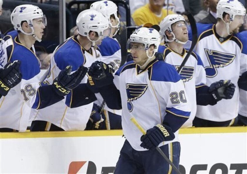 St. Louis Blues left wing Alexander Steen (20) is congratulated by Adam Cracknell (79) after Steen scored against the Nashville Predators in the second period of an NHL hockey game Tuesday, April 9, 2013, in Nashville, Tenn. (AP Photo/Mark Humphrey)