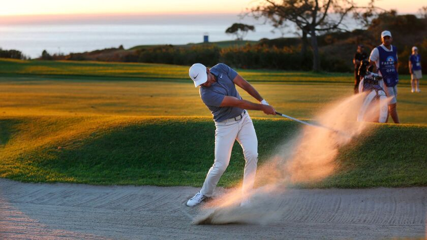 Jason Day hits from the sand on the 4th playoff hole during the Farmers Insurance Open at the Torrey Pines Golf Course on January 28, 2018. (Photo by K.C. Alfred/ San Diego Union-Tribune)