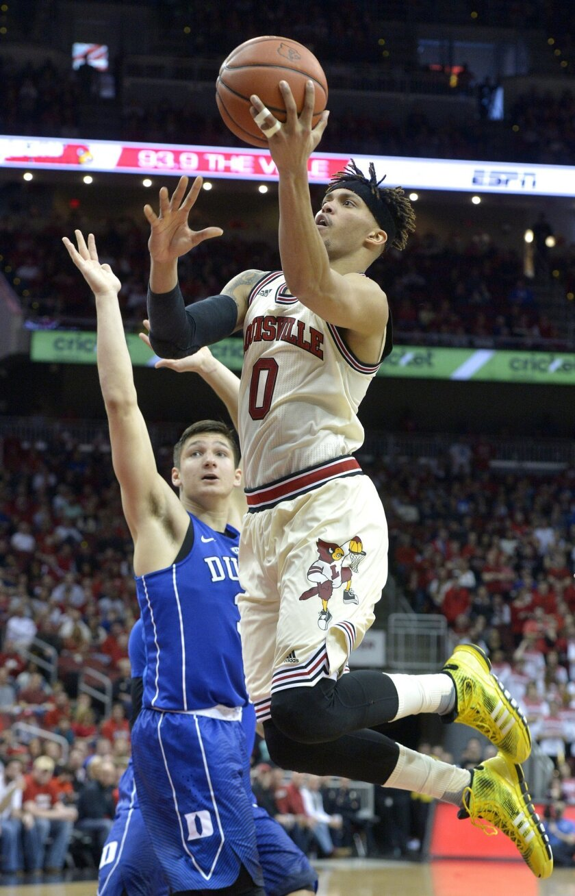 Louisville's Damion Lee (0) goes in for a layup past the defense of Duke's Grayson Allen (3) during the second half of an NCAA college basketball game, Saturday, Feb. 20, 2016 in Louisville Ky. Louisville won 71-64. (AP Photo/Timothy D. Easley)