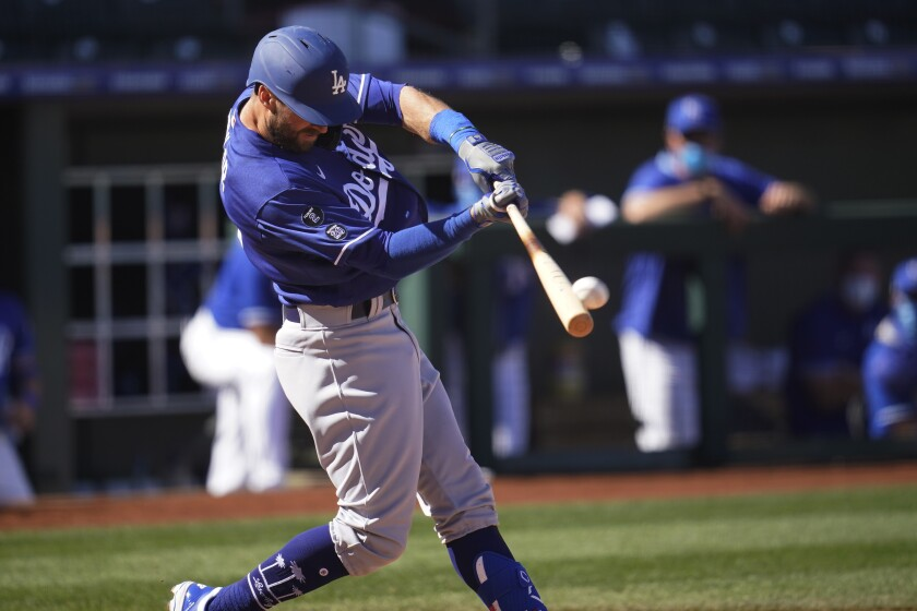 The Dodgers' Chris Taylor hits a grand slam in a spring training game against Kansas City on March 5, 2021.