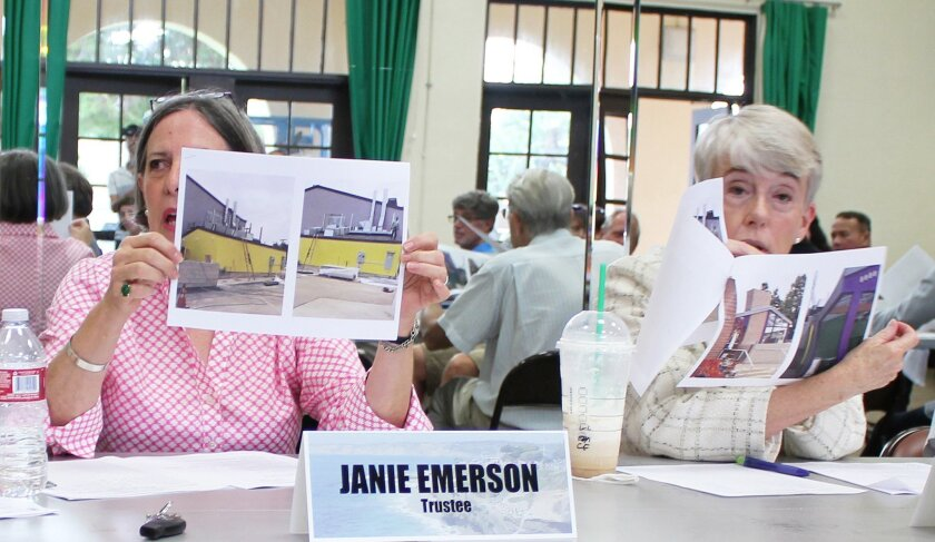 Trustees Janie Emerson and Dolores Donovan review photos of the Galaxy Taco restaurant under construction in the Shores.