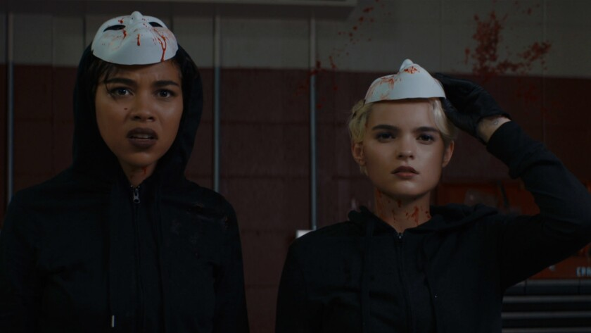 """Alexandra Shipp, left, and Brianna Hildebrand star as high school best friends whose obsession with popularity and crime leads them to kidnap a serial killer, for starters, in """"Tragedy Girls."""""""