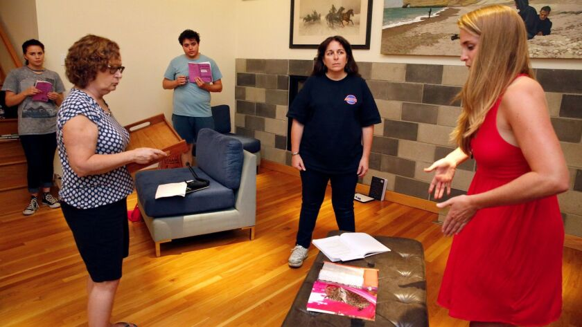 """Director Samantha Ginn (right) leads a rehearsal for the Deanna Jent play """"Falling."""""""