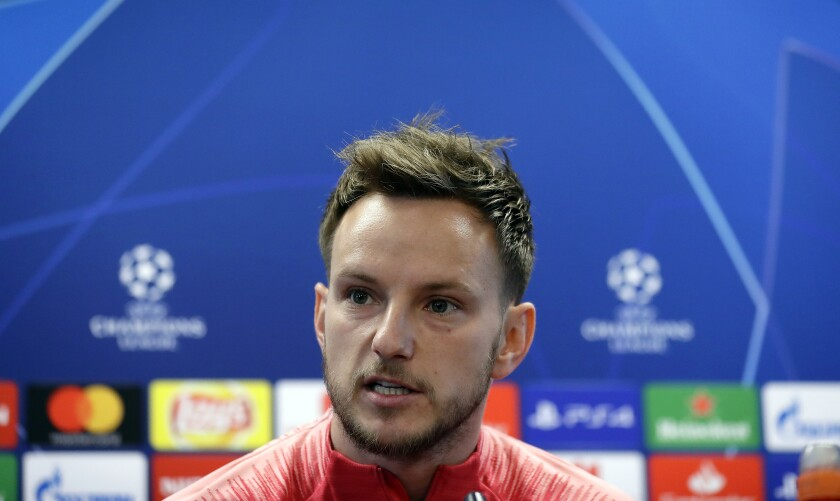 FILE - In this Tuesday, April 30, 2019 file photo, FC Barcelona's Ivan Rakitic attends a press conference at the Sports Center FC Barcelona Joan Gamper in Sant Joan Despi, Spain. The future of Ivan Rakitic and Arturo Vidal is in doubt as Barcelona approaches the winter transfer market. Both midfielders are proven winners with multiple titles in their careers. Rakitic has won a Champions League and four Spanish leagues for Barcelona. Vidal has collected a long list of silverware in Spain, Germany, Italy and for his Chile. (AP Photo/Manu Fernandez, file)
