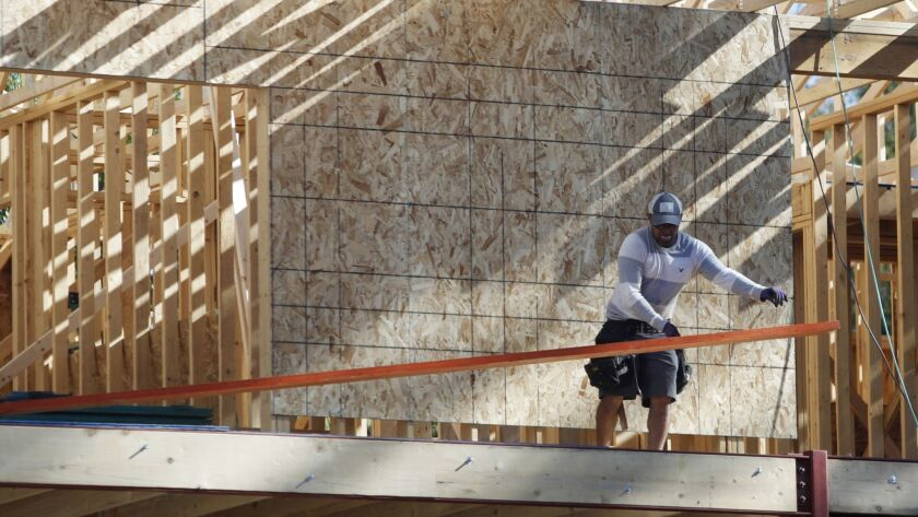 worker toils on new construction in denver, r m, housing, real estate, construction, economy