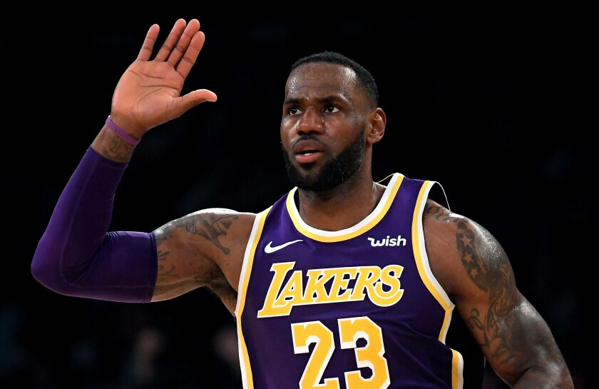Lakers star LeBron James celebrates after dunking on the Golden State Warriors during a 120-94 win Wednesday at Staples Center.