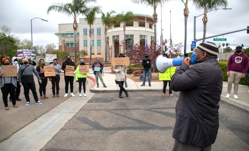 Yusef Miller, with the North County Equity and Justice Coalition, rallies outside the Escondido Police Station.