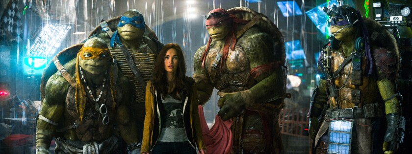 April (Megan Fox) joins forces with the turtles, including Michelangelo, left, Leonardo and Raphael.