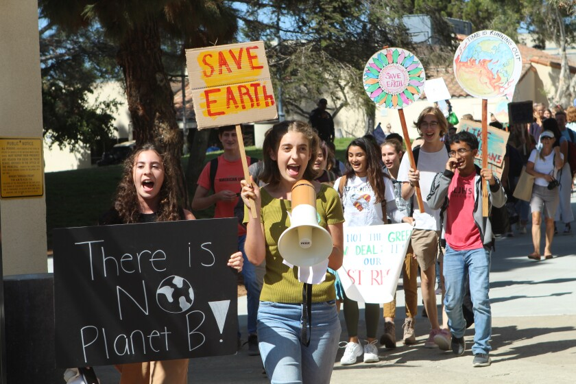 About 100 La Jolla High School students walked out of school 45 minutes early on Friday, Sept. 20, as part of the Global Climate Strike. Students chanted and carried signs supporting climate action.